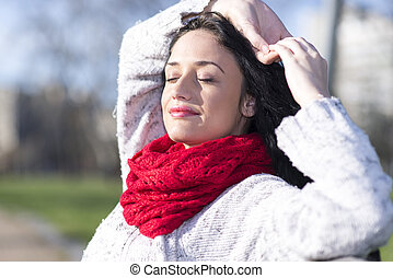 Young woman with red scarf