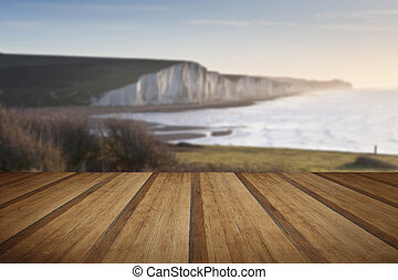Seven Sisters sunrsie viewed from Seaford Head with wooden...