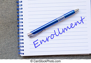 Enrollment text concept - Notepad and pen on wooden...
