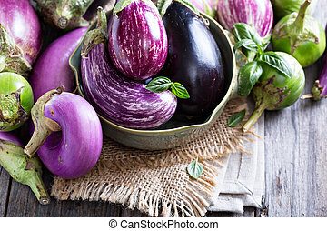 Eggplants of different variety on the table - Eggplants of...