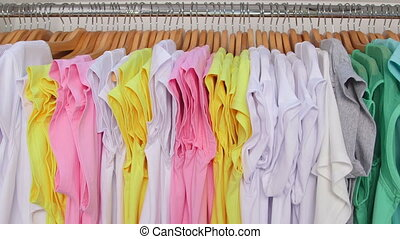 T-shirts hanging on hangers - Colorful new T-shirts hanging...