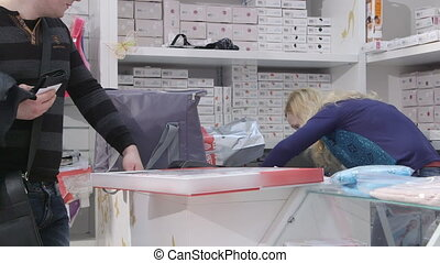 baby and maternity shop - Sales assistant serving customers...