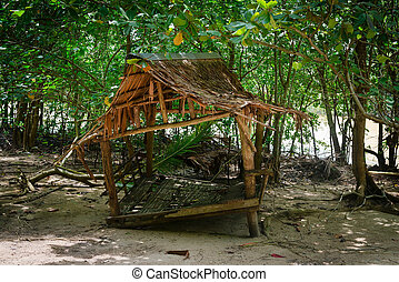 Dilapidated Nipa Rest House near a Tourist Beach in Thailand...