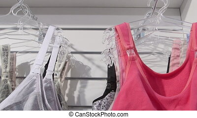 New cotton bras on hangers in lingerie and underwear...