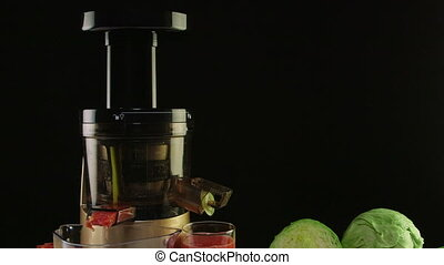 New masticating juicer machine making fresh vegetable tomato...