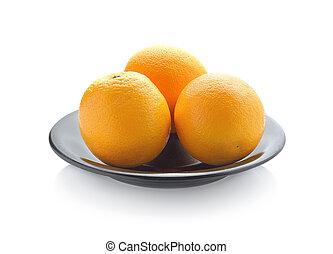 orange in dish isolated on white background