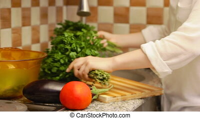 Woman preparing lettuce - Young woman making a salad with...