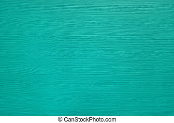 Pine board painted teal, wood grain texture showing through