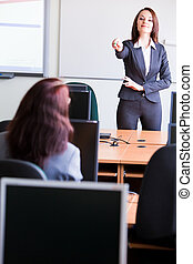 corporate trainning - woman presenting - woman making a...
