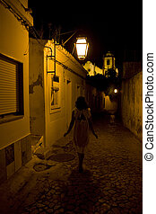 Girl in white walking down a street at night - Girl in a...