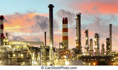 Oil refinery at night - Time lapse motion