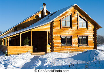 The snow-covered house. - The timbered country house in the...