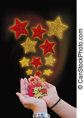 Magical stars - two hands holding a bunch of magical stars...