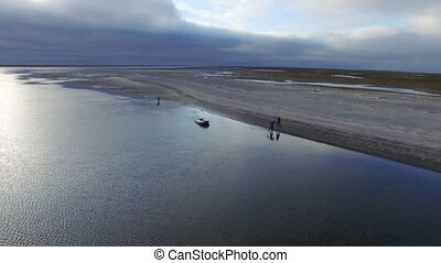 three geologist in the tundra, aerial shot
