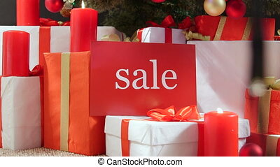 Christmas sale sign with wrapped gift boxes