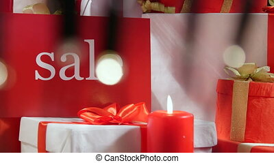 Christmas retail sale sign with wrapped gift boxes and...