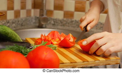 Woman preparing tomatoes