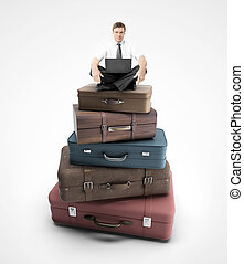 businessman sitting on bags - businessman sitting on travel...