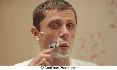 A man shaves
