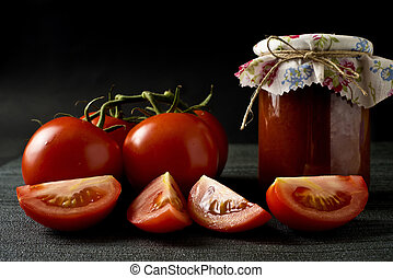 Jar of homemade sauce and fresh tomatoes - Jar of homemade...
