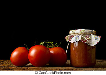 Jar of home made salsa with fresh tomatoes - Jar of homemade...