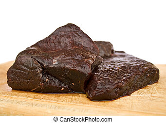 Raw whale meat - Steaks of minke whale meat, on a wooden...