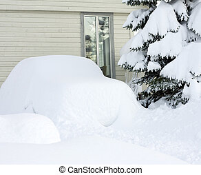Car covered in snow - Car parked outside a house, completely...