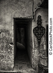 Dark alley in Fes, b&w image. - Entrance to narrow alley in...