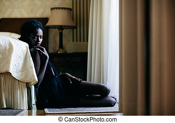 Young black woman in the room