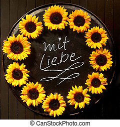 Sunflower frame with Mit Liebe text - Sunflower frame formed...