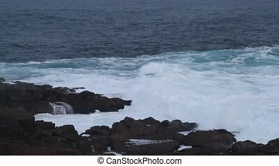 Atlantic Canada Coastline - Ocean waves breaking on rocks.