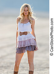 Blonde Model in Desert - A blonde model posing in a desert...