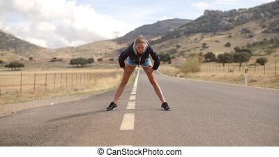 Fitness Lady Doing Stretch ups Before Run, Spanish Mountains...