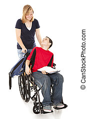 Disabled Boy and Friend - Teen girl pushing her disabled...