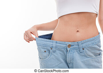 Fit young healthy woman is dieting successfully - Close up...