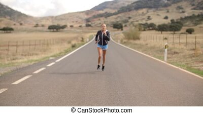 Fitress Girl Running on the Road in Mountains on Slow Motion...