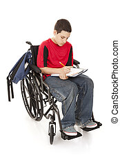 Disabled School Boy - Disabled teenage boy doing homework in...