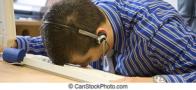 asleep - young modern business man with headset asleep at...