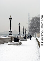 Walking in the Snow - A single pedestrian walking in the...