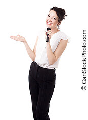 Young female emcee with microphone on white background -...