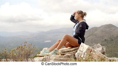 Fit Woman Resting at Rock - Fit Woman Resting at Top of The...