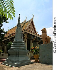 Wat Phnom, Phnom Penh. Cambodia - Lion and stupa in from of...