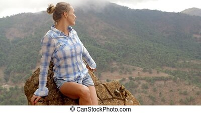 Girl Resting Near Rock in Spanish Mountains on Slow Motion...