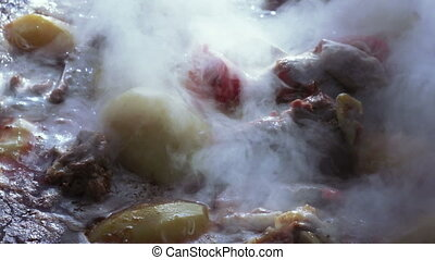 Cooking soup - Surface of vat of boiling soup
