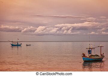 Fishing boats at dawn - Image of small fishing vessels at...