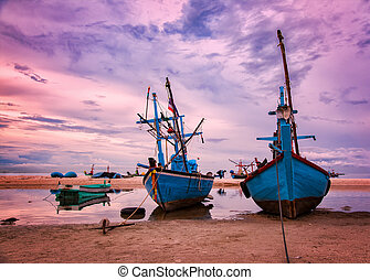 Fishing vessels at dawn - Image of small fishing vessels on...