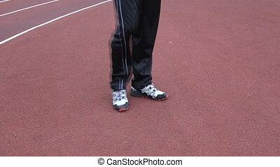 Runner warming up legs flexing - Runner warming up legs