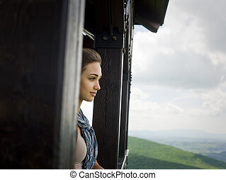 High up - Portrait of a young brunette beauty observing the...