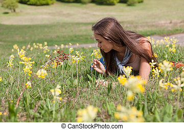 Sun drenched meadow. - Brunete beauty enjoying relaxation in...