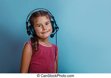 Girl European appearance decade listening to music with...